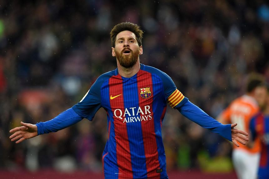 Barcelona's Argentinian forward Lionel Messi celebrating after scoring a goal during the Spanish league football match between Barcelona and CA Osasuna at the Camp Nou stadium in Barcelona on April 26, 2017.