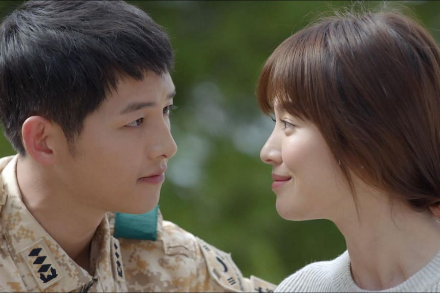 Song Joong Ki (left) and Song Hye Kyo sharing a moment in the Korean drama series Descendants Of The Sun.