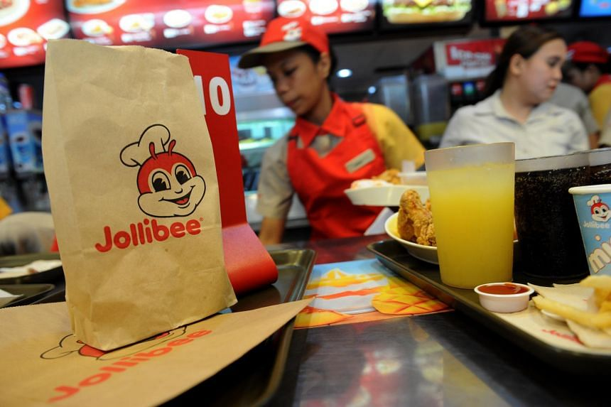 Jollibee Foods employees attending to customer orders at a Jollibee store in Manila on Oct 14, 2015.