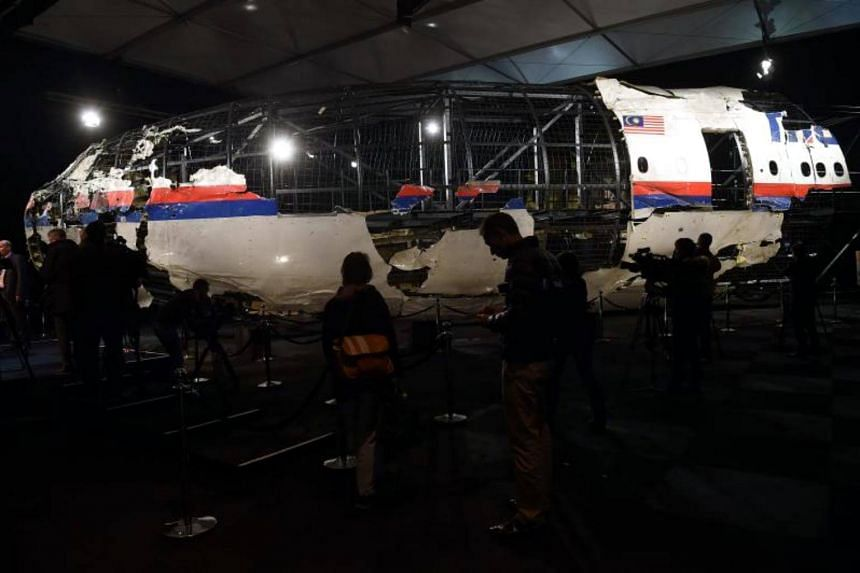 The wrecked cockpit of the Malaysia Airlines flight MH17, presented to the press during a presentation of the final report on the cause of the its crash, in 2015.
