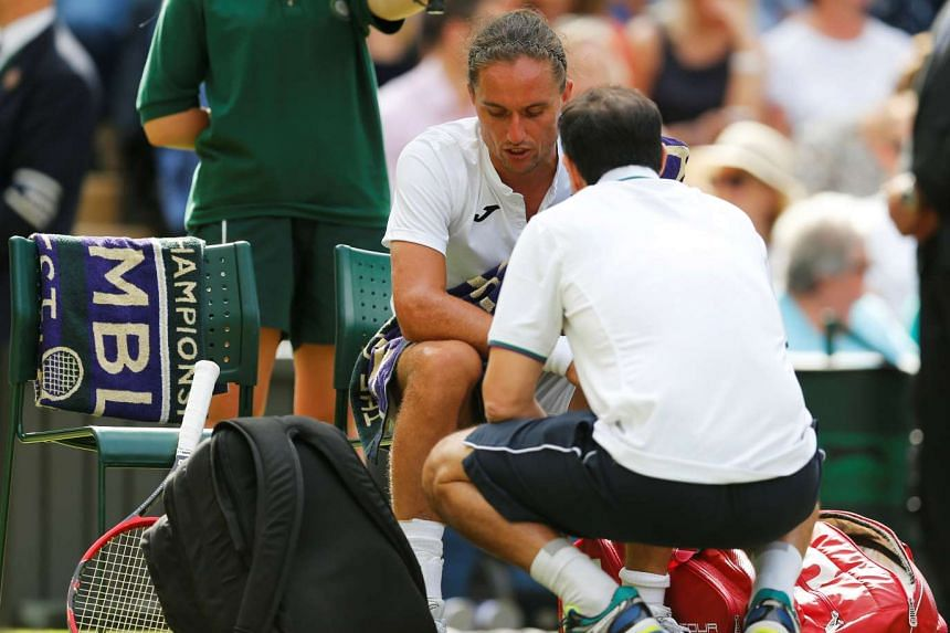 Federer reached the Wimbledon second round when Alexandr Dolgopolov (above) quit due to an ankle injury.