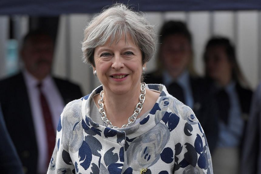 Britain's Prime Minister Theresa May leaving after attending the annual Henley Royal Regatta rowing festival in Henley-on-Thames, Britain on June 30, 2017.