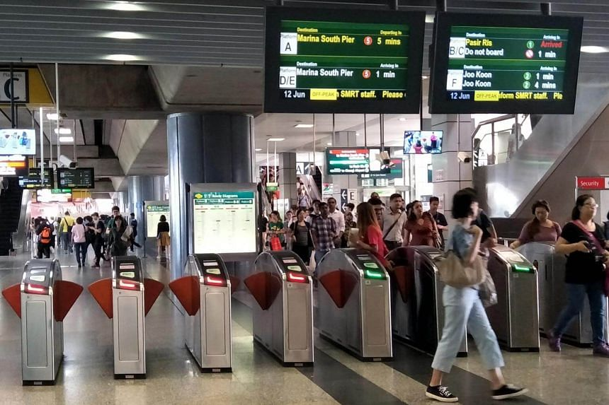 Commuters at Jurong East MRT station.