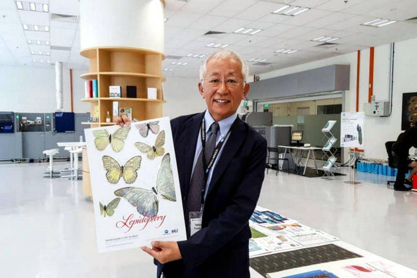 Mr Tadayuki Funakura, Managing Director of Konica Minolta BSA, with a print sample at the company's newly launched Customer Engagement Centre at Techlink Singapore, 31 Kaki Bukit Road.