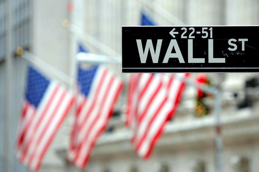A street sign for Wall Street is seen outside the New York Stock Exchange (NYSE) in New York City, US, on Dec 28, 2016.