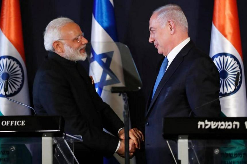 Indian Prime Minister Narendra Modi (left) shakes with his Israeli counterpart Benjamin Netanyahu during a press conference in Jerusalem on July 5, 2017.