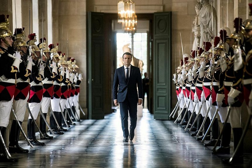 """French President Emmanuel Macron on his way to meet lawmakers at Versailles Palace on Monday. By meeting at the 17th-century palace built by the """"Sun King"""", Mr Macron was seeking to restore old-fashioned grandeur to the role."""