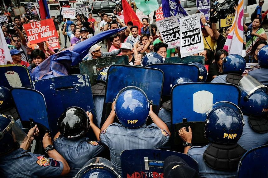 Activists clashing with anti-riot police during a protest near the United States Embassy in Manila yesterday. The activists were calling for an end to US military intervention in Marawi and Mindanao. Philippine President Rodrigo Duterte had declared