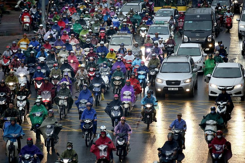 Vehicles on a congested road in Hanoi, Vietnam, last Thursday. The decision to ban the two-wheelers in the capital city, which has around five million motorcycles and 500,000 cars spread among a population of about seven million, was approved by 95 o