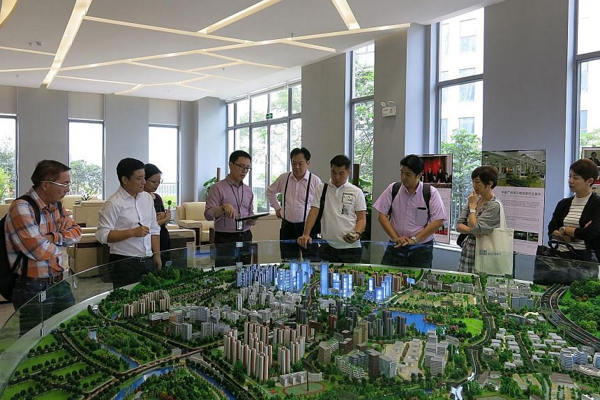 Participants of the China Ready Programme viewing a model at Guangzhou Knowledge City. The new programme, which is aimed at helping small and medium-sized enterprises break into the Chinese market, saw a total of six Singapore companies from sectors