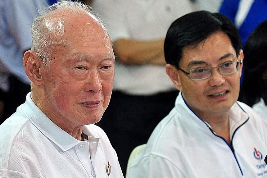 Mr Lee Kuan Yew, then Minister Mentor, speaking to residents of Tampines GRC in 2011. With him is Mr Heng Swee Keat, who was Mr Lee's principal private secretary from 1997 to 2000.