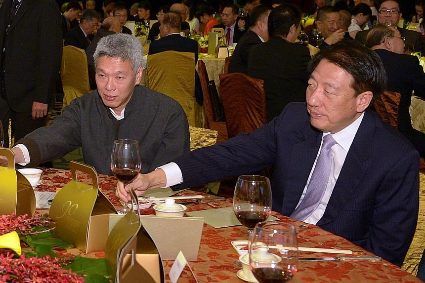 Mr Lee Hsien Yang and Mr Teo Chee Hean at a Business China dinner celebrating Mr Lee Kuan Yew's 90th birthday. The younger Mr Lee represented his father at the dinner.