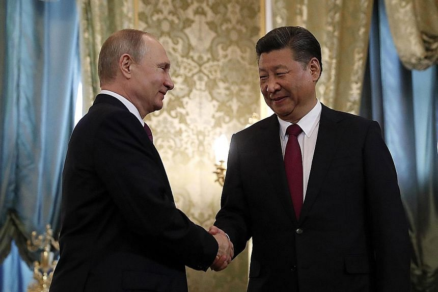 The joint statement was issued after a meeting between Russian President Vladimir Putin (far left) and Chinese President Xi Jinping in Moscow.