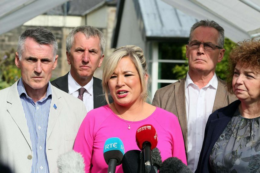 Sinn Fein leader Michelle O'Neill (centre) gives a statement as talks continue to form a power-sharing government.