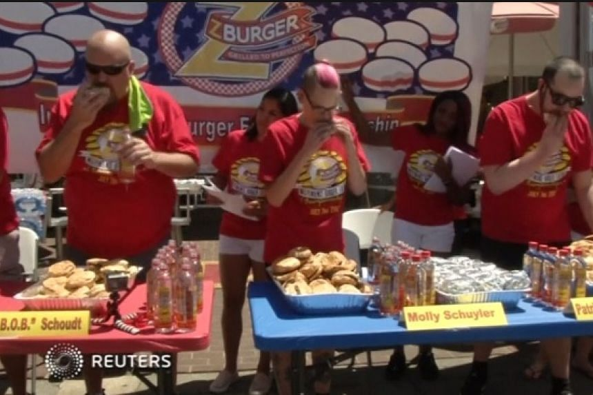 Competitive eater Molly Schuyler beat 13 other contestants to win Z-Burger's Annual Independence Burger Eating Championship on July 3.