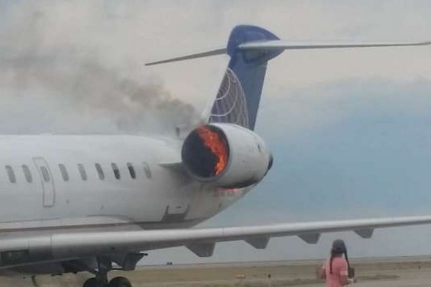 The engine of a SkyWest passenger jet caught fire moments after the aircraft landed at Denver International Airport on Sunday.