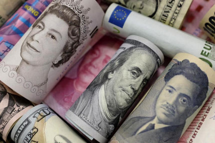 Bank notes of Euro, Hong Kong dollar, U.S. dollar, Japanese yen, GB pound and Chinese yuan are seen in this picture illustration. PHOTO: REUTERS