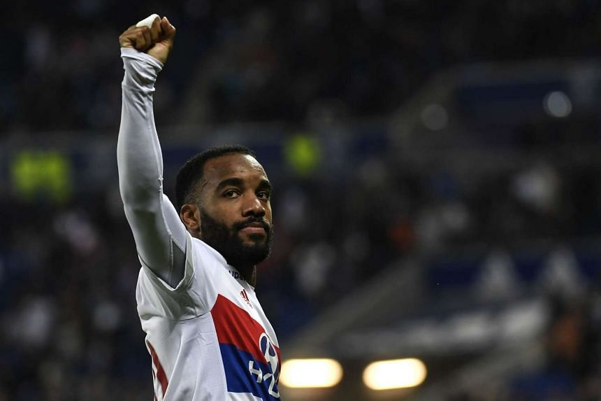 Lacazette reacts after scoring a goal during the French L1 football match between Lyon (OL) and Nice (OGCN) on May 20, 2017.