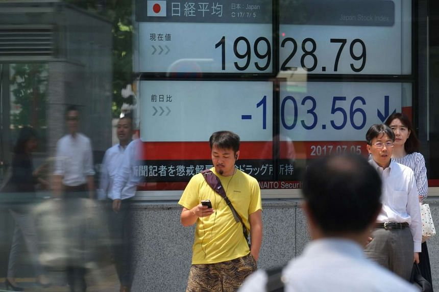 The stock quotation board flashing the Nikkei 225 key index of the Tokyo Stock Exchange in front of a securities company in Tokyo.