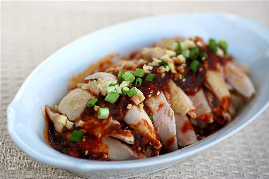 The Sichuan-style chicken gives a fiery spicy kick with ingredients like chilli powder, cardamoms and cinnamon stick use to make the chilli oil.