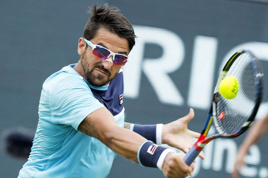 Tipsarevic (above) says players who pocket prize money for such brief encounters should not be judged.