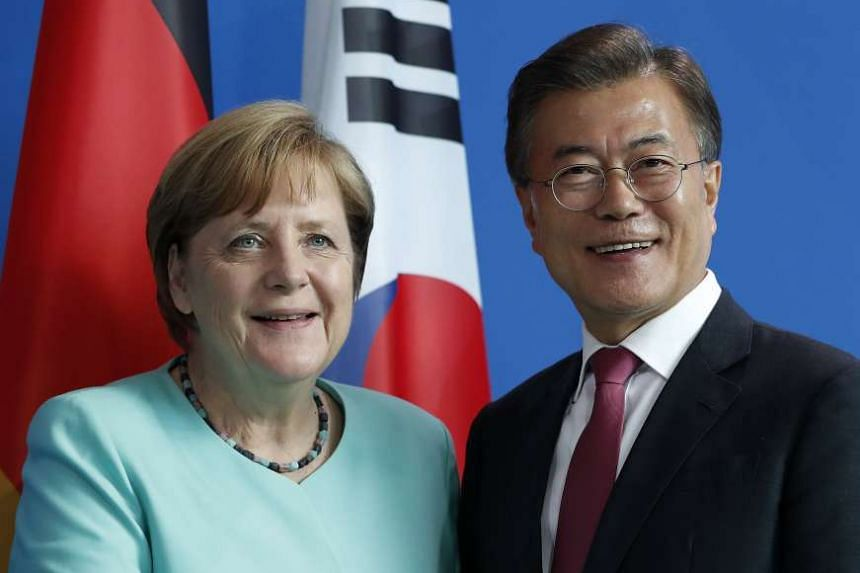 Moon (right) and Merkel at their joint press conference, July 5, 2017.