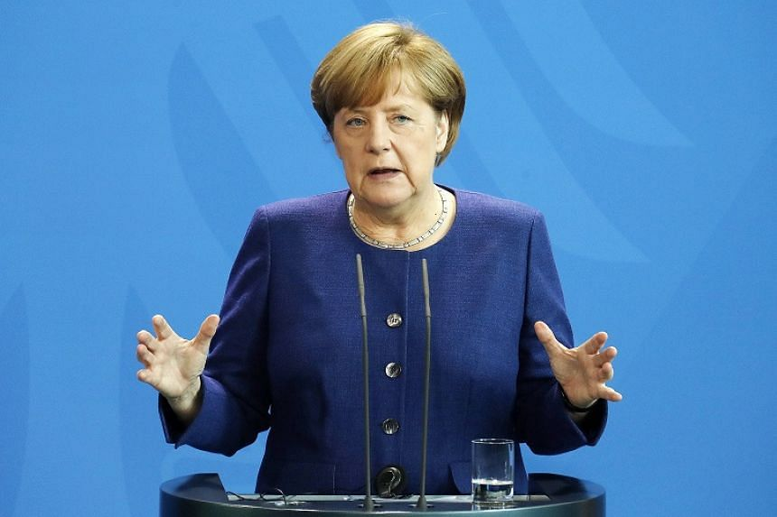 Merkel told reporters that as host of the G-20 summit, it was her role to find compromises.