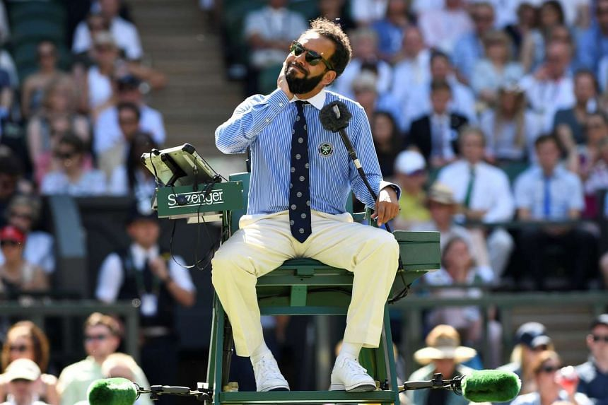 Umpire Kader Nouni on centre court reacts after he was surrounded by flying ants.
