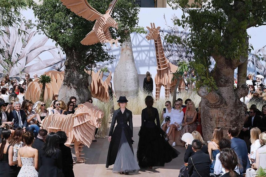 There were lions and giraffes when Dior celebrated its 70th anniversary on Monday with a show outside the Invalides museum in Paris. The animal props were a link to the brand's founder Christian Dior's travels around the world. On a fern-lined catwal