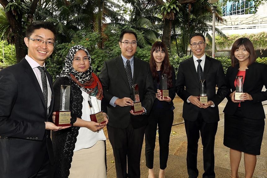Receiving the Outstanding Youth in Education Award 2017 are (from left): Mr Chew Jing Wen, Madam Farah Haider Alsagoff, Mr Simon Sng, Ms Sarene Loh, Mr Muhamad Fadly and Ms Faith Huang.