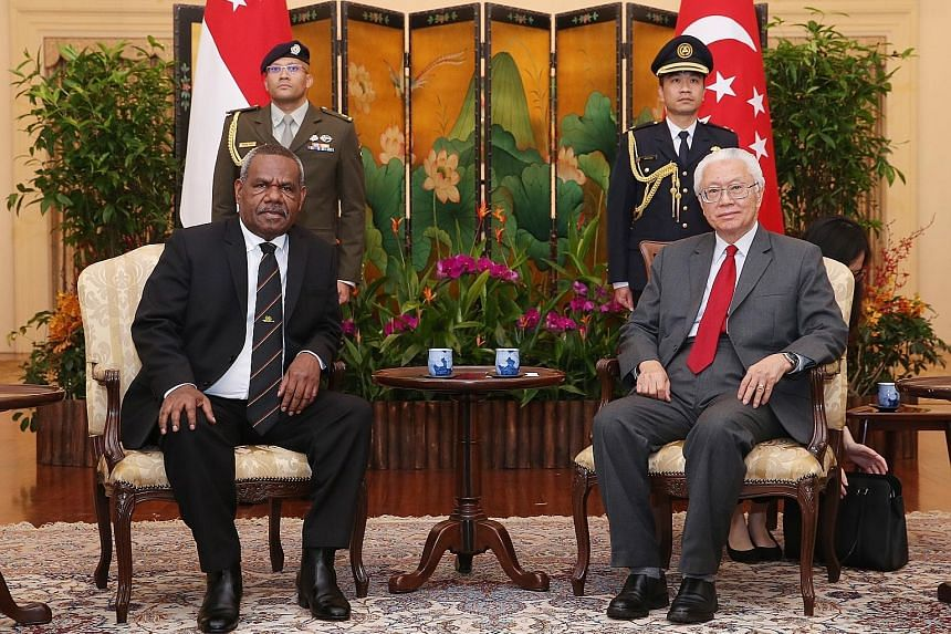 """Governor-General of Papua New Guinea Bob Dadae paying a courtesy call to President Tony Tan Keng Yam at the Istana yesterday afternoon. In a Facebook post, Dr Tan noted that Singapore shares """"warm and friendly relations"""" with Papua New Guinea, adding"""