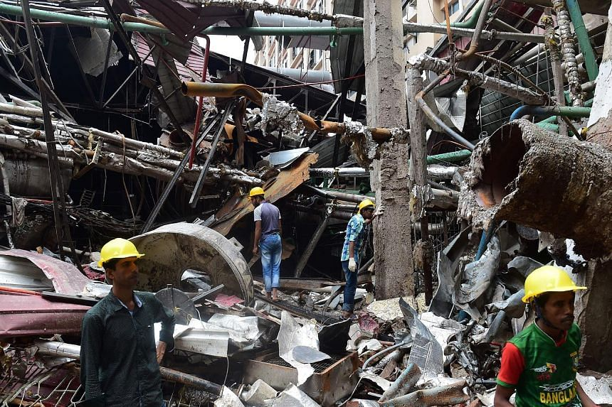 Bangladeshi workers taking part in a search and rescue operation at a destroyed garment factory in Gazipur on Tuesday after a boiler explosion at the complex on the outskirts of Dhaka that killed 13 people and injured dozens. Police have filed charge
