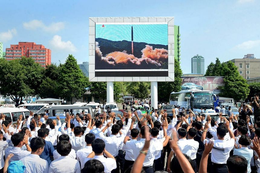 A photo released yesterday by the Korean Central News Agency showing North Koreans cheering the launch of an ICBM that some analysts say could reach as far as Alaska, if reports of its range of 6,700km are correct. A US Multiple Launch Rocket System