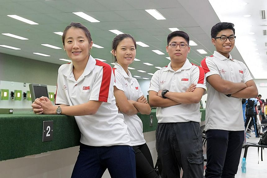 Four Singapore shooters - (from left) Lim Yee Xien, Phaedra Tan Yee Joo, Sng Jian Hui and Mohd Irwan - will each make their SEA Games debut next month.
