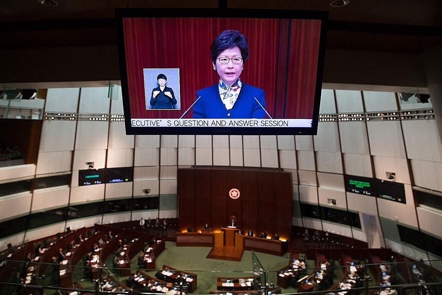 Ms Carrie Lam speaking in the Legislative Council chamber yesterday. The new Hong Kong leader said her government would lobby the chamber's democratically elected members directly to ensure their concerns were heard.