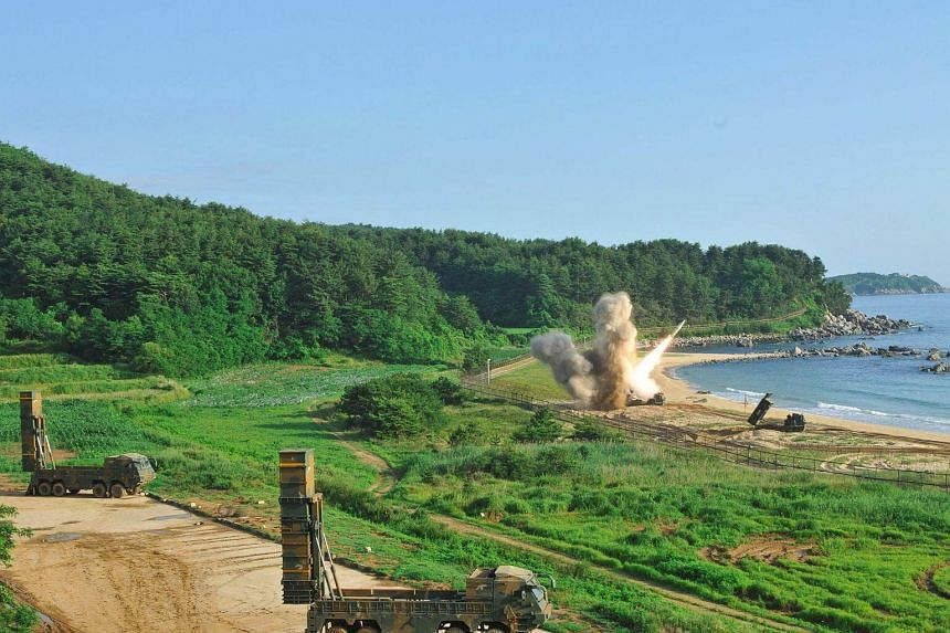 US M270 Multiple Launch Rocket System (right) firing an MGM-140 Army Tactical Missile into the East Sea from an undisclosed location on South Korea's east coast.
