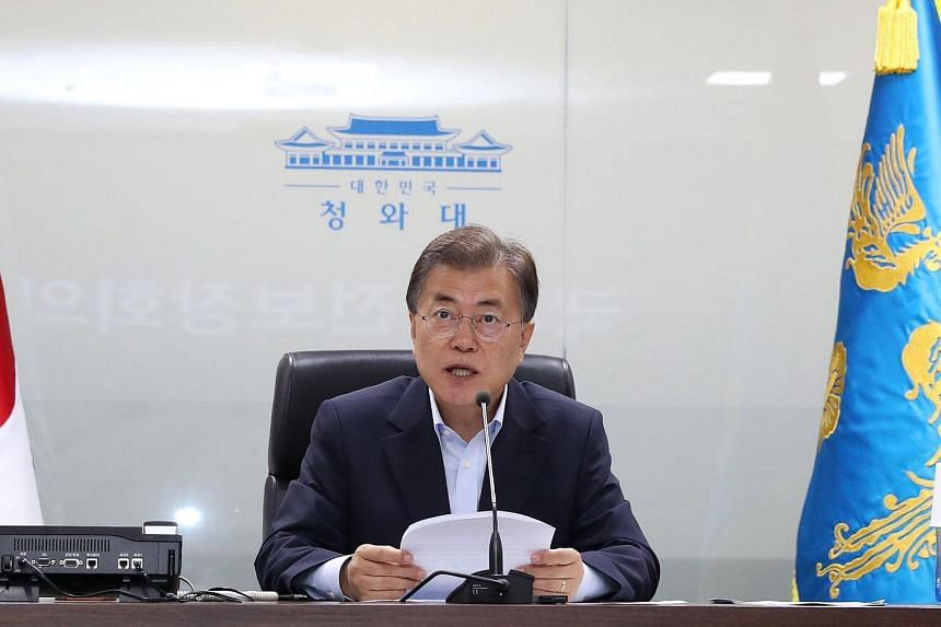 South Korean President Moon Jae In presides over a meeting of the National Security Council at the presidential office Cheong Wa Dae in Seoul, on July 4, 2017.