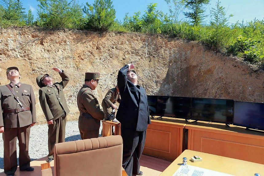 North Korean leader Kim Jong Un (right) inspecting the successful test-fire of the intercontinental ballistic missile Hwasong-14 at an undisclosed location.