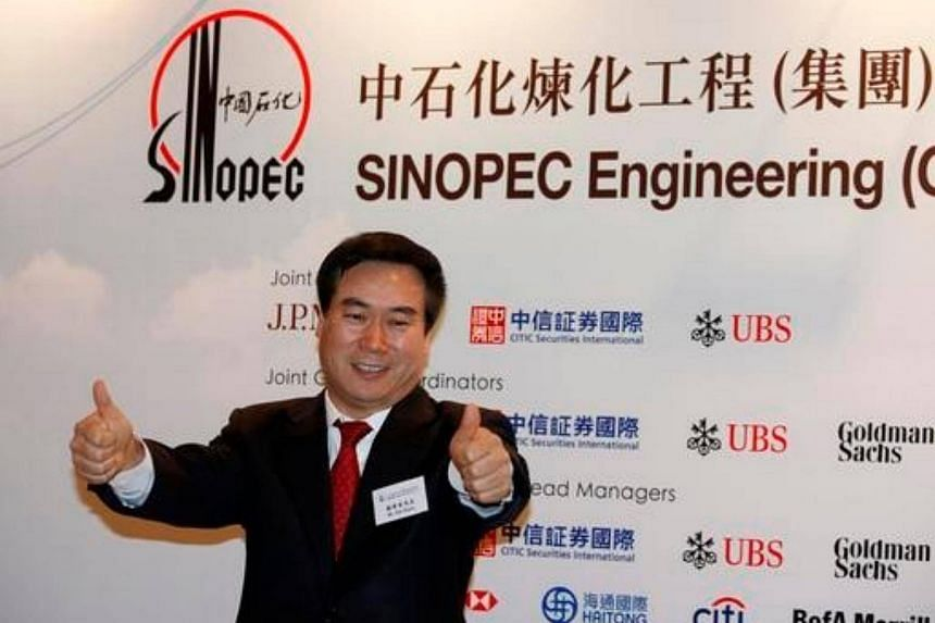 Sinopec Engineering (Group) Co. Ltd ex-chairman Cai Xiyou gestures before attending an investor presentation for their global offering in Hong Kong on May 6, 2013.