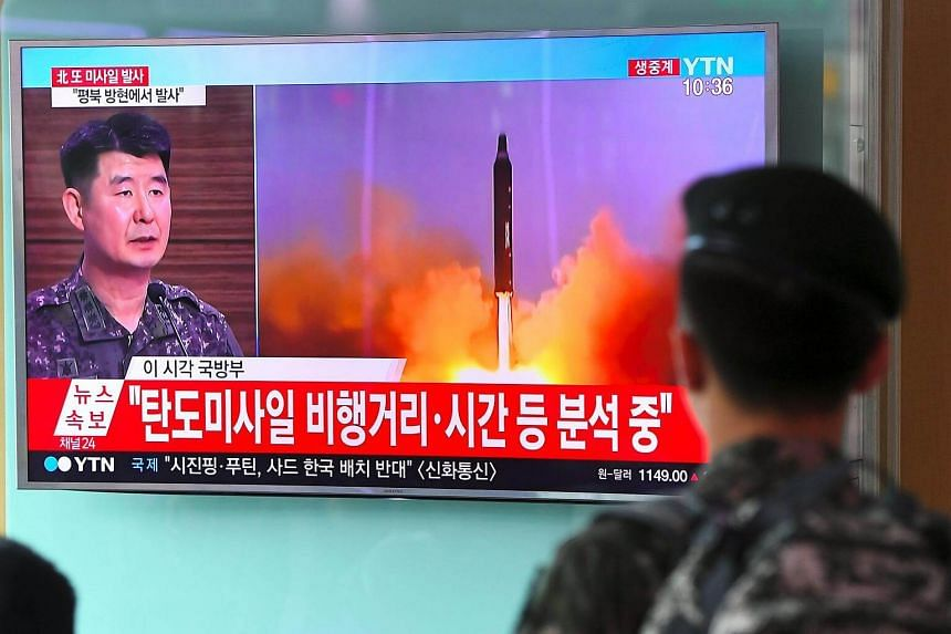A South Korean soldier watches file footage of a North Korean missile launch, at a railway station in Seoul on July 4, 2017.