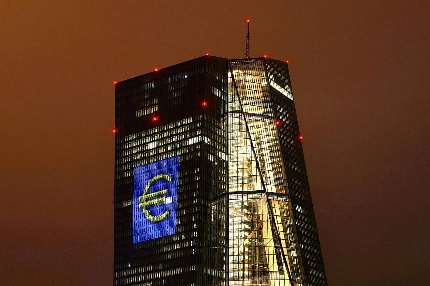 "The headquarters of the European Central Bank (ECB) are illuminated with a giant euro sign at the start of the ""Luminale, light and building"" event in Frankfurt, Germany, March 12, 2016."