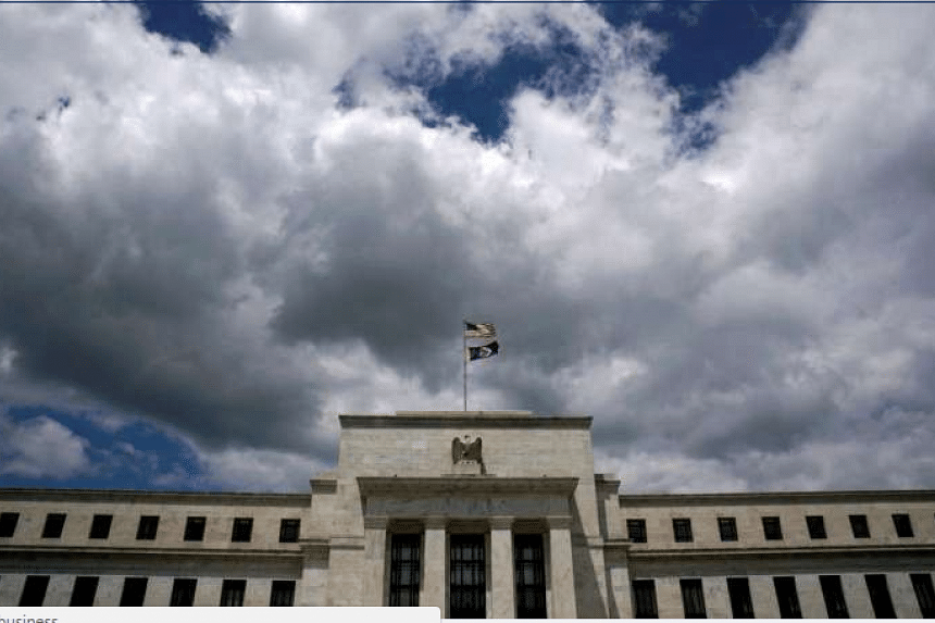 Flags fly over the US Federal Reserve in Washington.