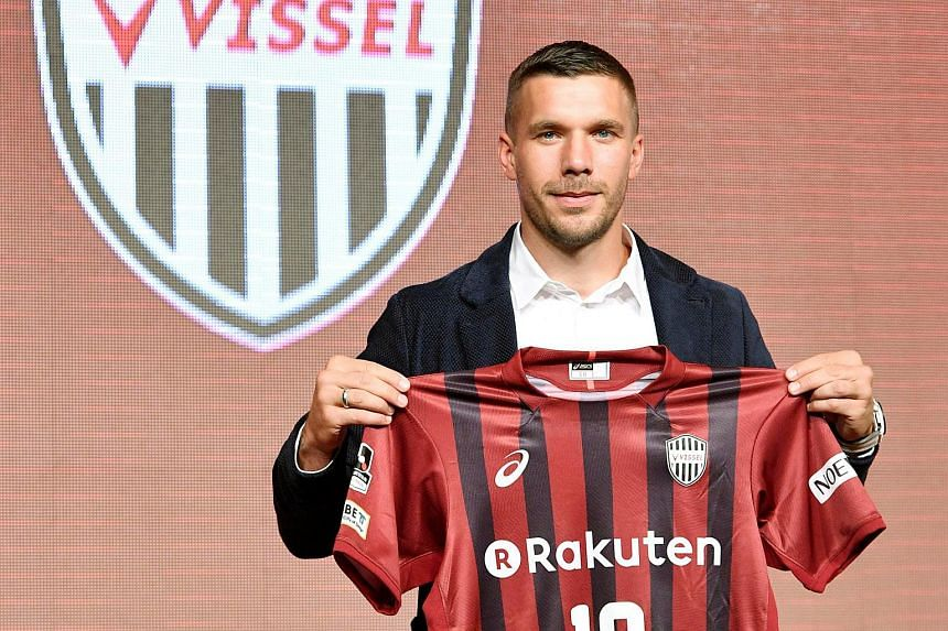 Germany's Lukas Podolski poses with his new team jersey during a news conference in Kobe, Japan on July 6, 2017.