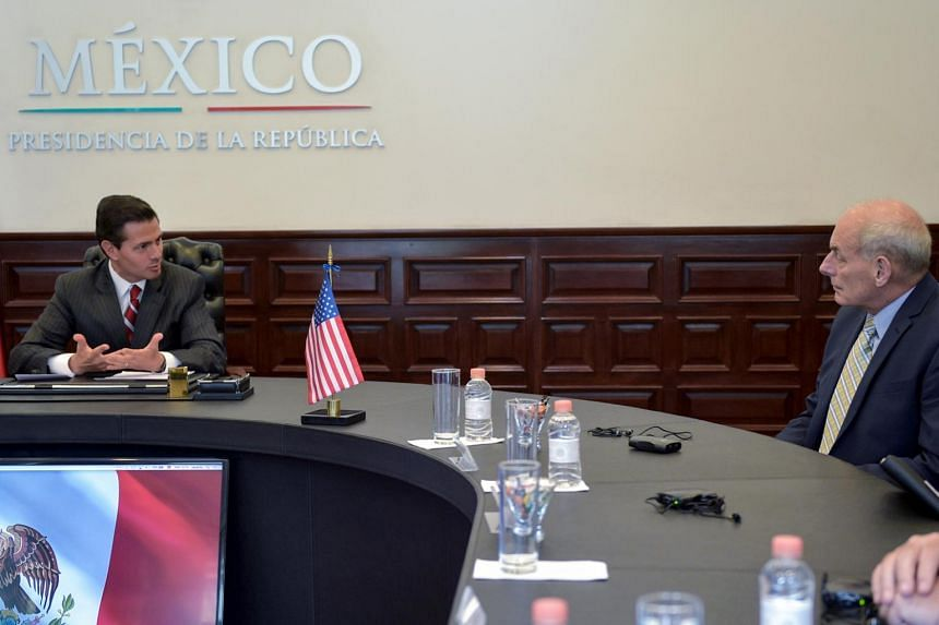 Mexican President Enrique Pena Nieto (left) talking with US Homeland Security Secretary John F. Kelly at Los Pinos presidential residence in Mexico City.