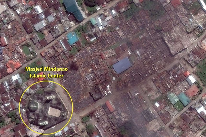 Though much of the surrounding area is flattened, the Masjid Mindanao Islamic Center is intact.