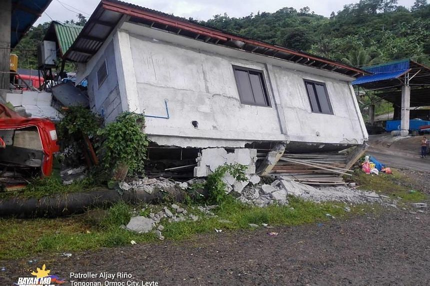 Collapsed houses in Tongonan district in Ormoc city, Leyte province.