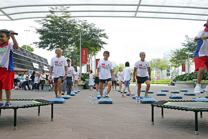 (From left to right) Victor Chan, 65, Ng Bee Kia, 72, and Ngai Hin Kwok, 68, the members of Team Strong Silver launch the 3M Step-Up Challenge @ South East to mark the community initiative's fifth year milestone on July 6, 2017.