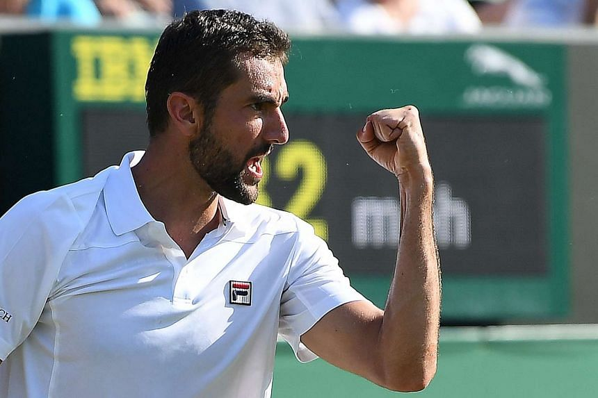 Cilic celebrates after winning against Germany's Florian Meyer.