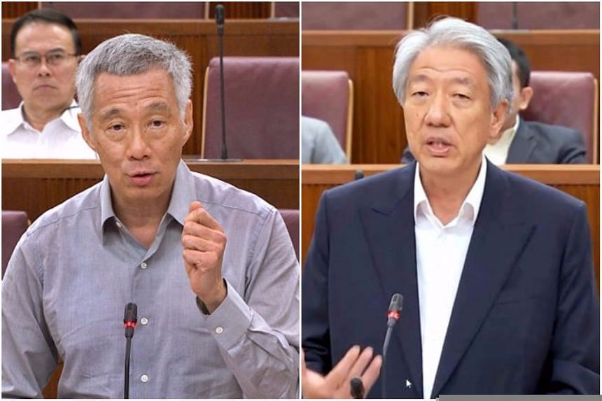 Prime Minister Lee Hsien Loong and Deputy Prime Minister Teo Chee Hean speak in Parliament.