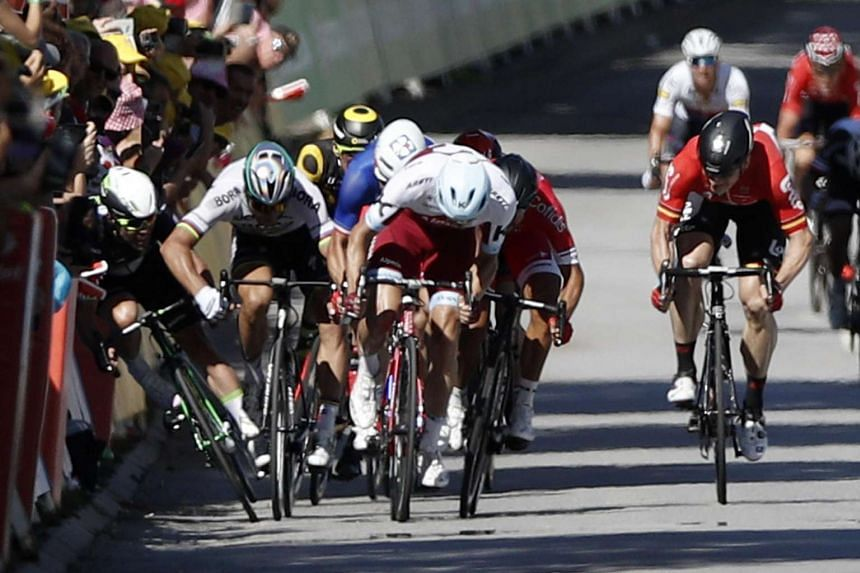 Bora Hansgrohe team rider Peter Sagan (2-L) of Slovakia pushes Team Dimension Data rider Mark Cavendish (L) of Britain during the final sprint of the 4th stage of the 104th edition of the Tour de France.